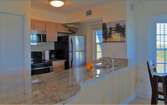 Ocean Pointe Suites at Key Largo Bedroom Kitchen