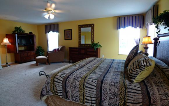 Master Bedroom with personal seating area - Pine Forest Chateau - 5 bedroom Walt Disney World Area vacation home - Homes4uu