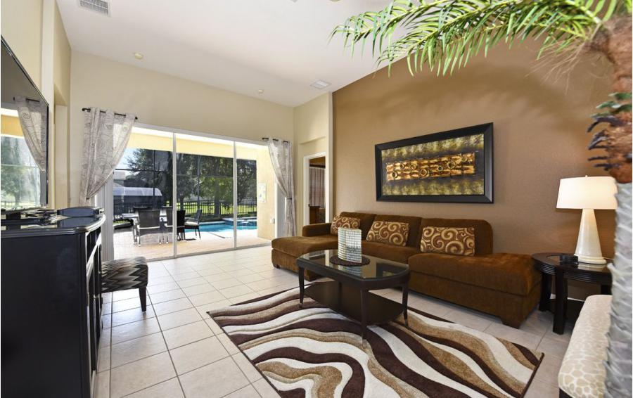 Living Room with Pool Deck Access - Mizzen Staysail - 5 Bedroom Kissimmee Area Private Pool Home - Homes4uu