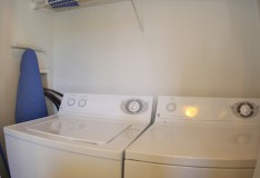 Laundry Room - 1 bedroom Runaway Beach Club condo - Homes4uu