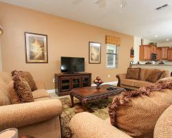 Great Room with TV - Galleon II - 8 Bedroom Private Pool Rental Vacation Home - Homes4uu