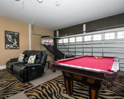 Garage Game Room - Flying Jib II - 9 Bedroom Disney area vacation home - Homes4uu