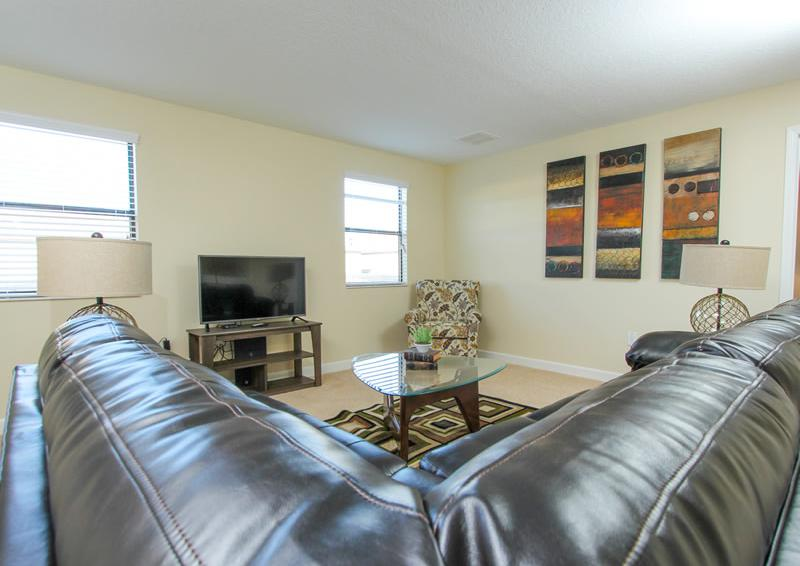 Leather Sectional Seating - Captain's Table - 6 Bedroom Orlando Vacation Home near Disney - Homes4uu