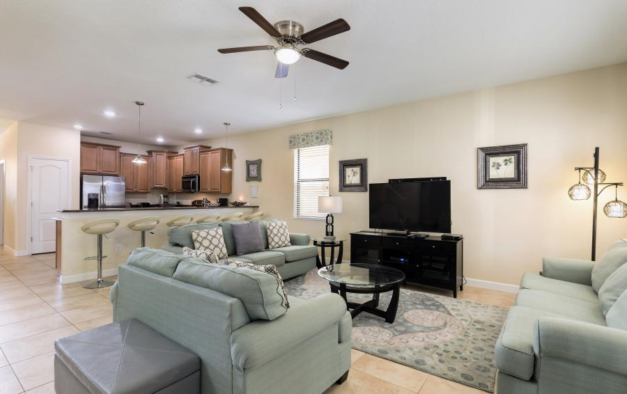 TV and the Great Room - Downhaul 8 Bedroom Vacation Home Near Disney - Championsgate Home - Homes4uu