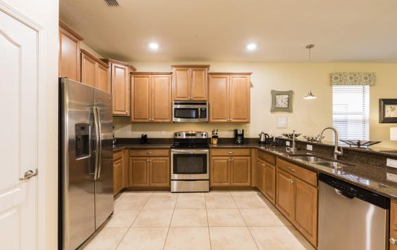 Kitchen with beautiful Appliances - Downhaul 8 Bedroom Vacation Home Near Disney - Championsgate Home - Homes4uu