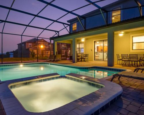 Pool Lit up at Night - Mainbrace - 8 Bedroom Orlando Vacation Home - Homes4uu