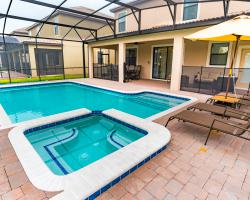 In Ground Pool and Spa - Nadir - 8 bedroom Disney World area home - Homes4uu