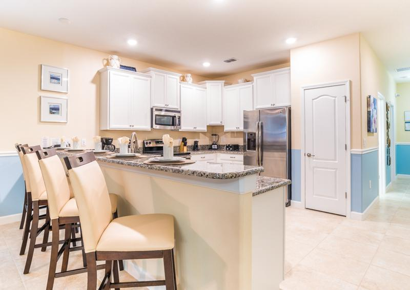 Kitchen and Breakfast Nook - Clove Hitch - 9 bedroom Walt Disney World Area Home - Homes4uu