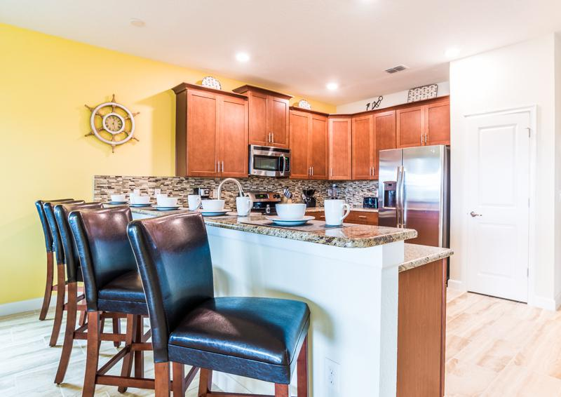 Kitchen and Breakfast Room - Grapeshot Beautiful 9 bedroom Champions Gate Vacation Home - Homes4uu