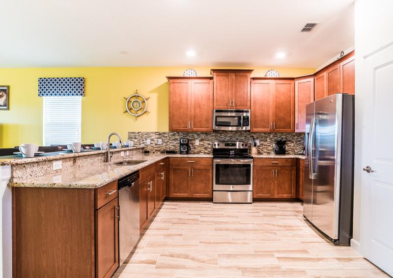 Kitchen - Grapeshot Beautiful 9 bedroom Champions Gate Vacation Home - Homes4uu