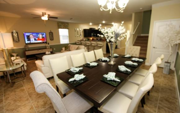 Celeste - 9 Bedroom Orlando Vacation Home - Homes4uu - Large Dining Table in the Dining Area