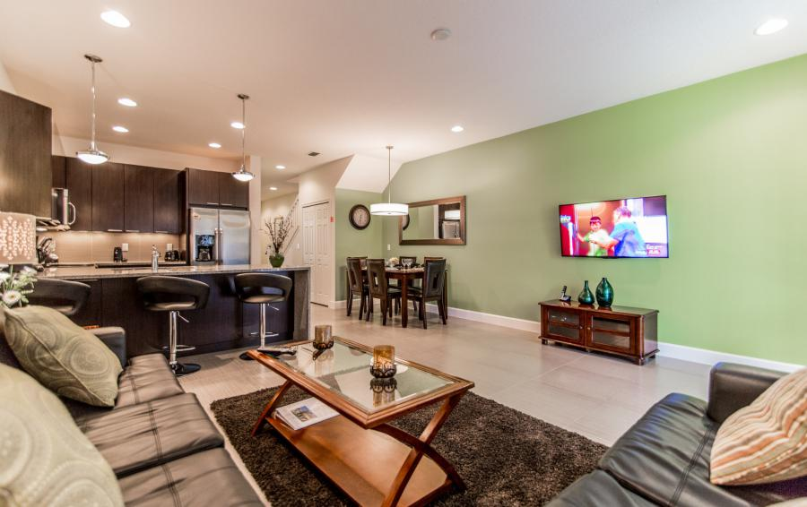 Great Room and TV into the Kitchen - Ocean Whisper - 3 Bedroom Townhouse with a Pool - Homes4uu