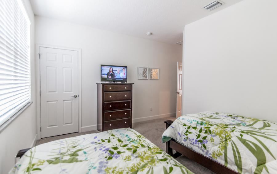 Bedroom 2 With TV - Ocean Whisper - 3 Bedroom Townhouse with a Pool - Homes4uu