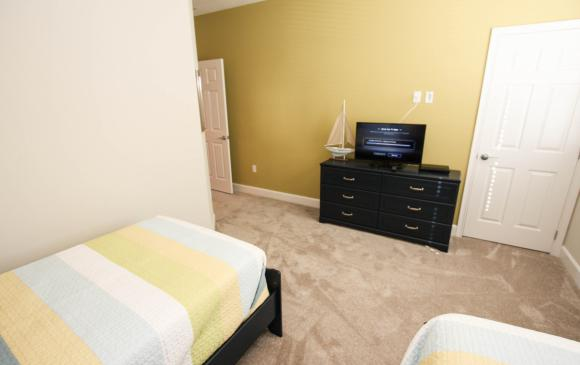 Twin Bedroom with Entertainment Center - Swift Sails II 3 Bed Vacation Townhouse - Dream Resort - Homes4uu