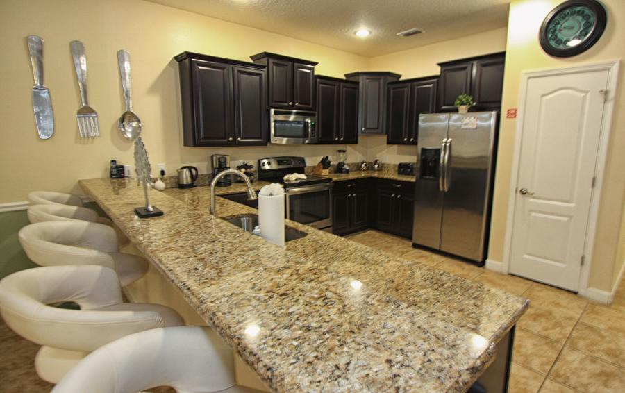 Open Floor Plan Kitchen with Breakfast Bar - Celeste 9 Bedroom Orlando Vacation Home - Championsgate Resort - Homes4uu