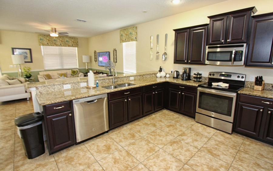 Kitchen with Stainless Steel Appliances - Celeste 9 Bedroom Orlando Vacation Home - Championsgate Resort - Homes4uu