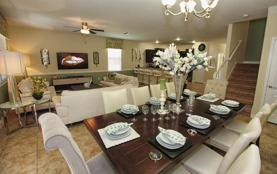 Great Room Dining Area with Views into the Kitchen - Celeste 9 Bedroom Orlando Vacation Home - Championsgate Resort - Homes4uu