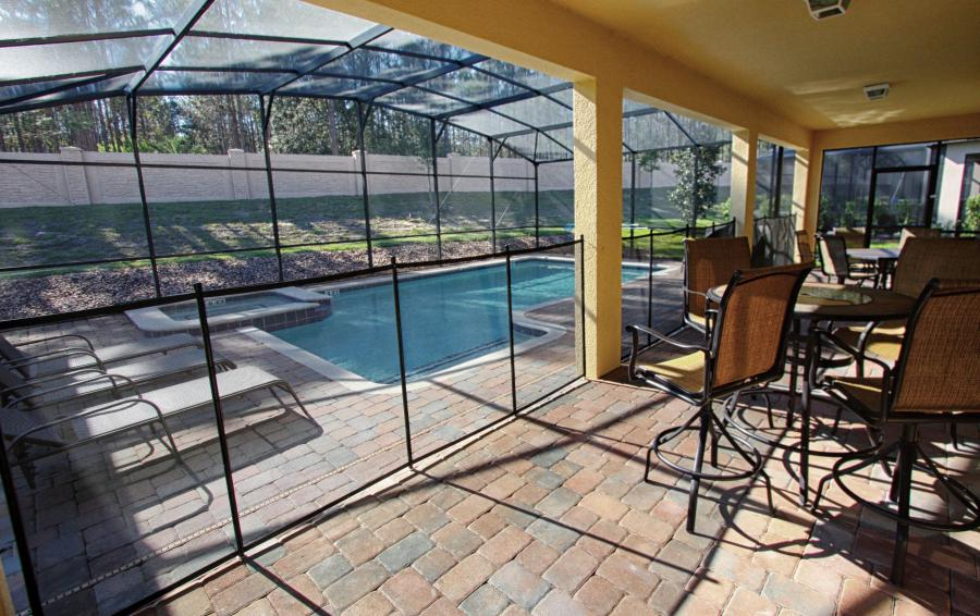 Screened in Pool and Pool Deck - Celeste 9 Bedroom Orlando Vacation Home - Championsgate Resort - Homes4uu