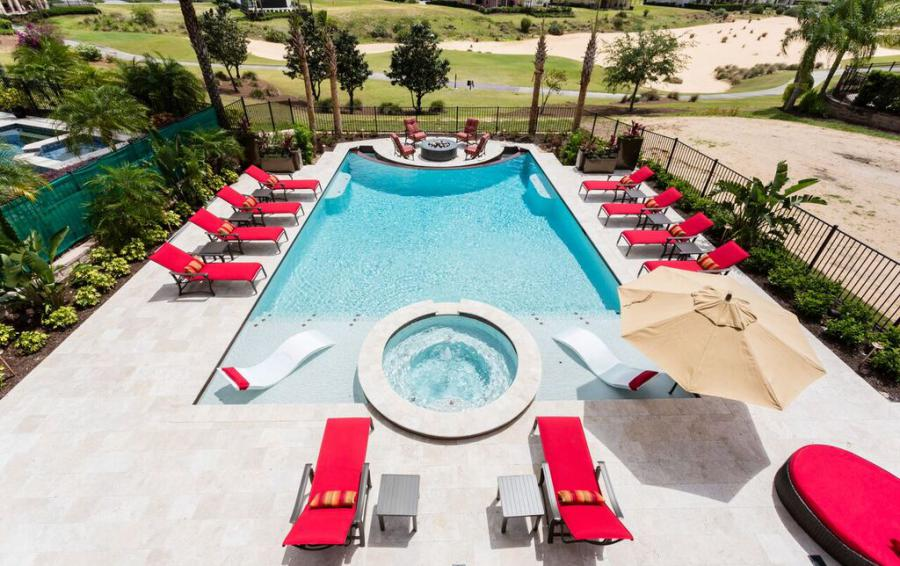 Balcony View of the Pool Spill Over Spa and the Firepit - Treasure Hunt - 8 Bedroom Hidden Mickey Vacation Home - Homes4uu