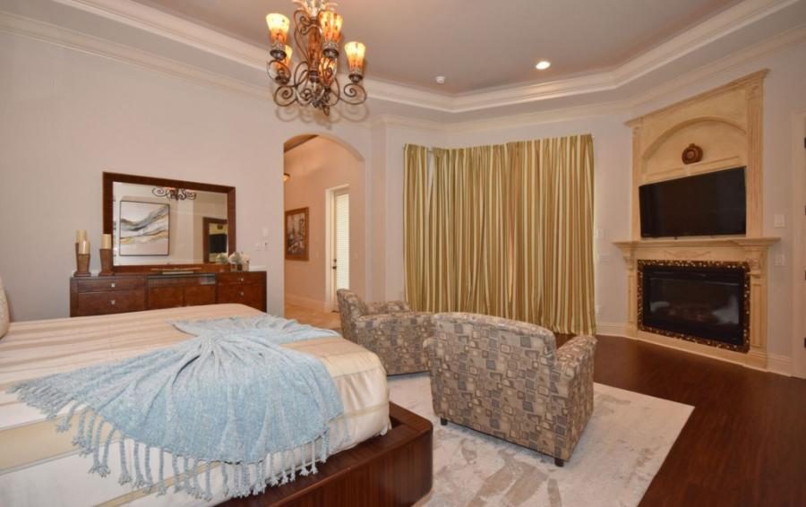 Bedroom - 1 - Fire Place Focal with Smart TV - Swift Sailing - 6 Bedroom Custom Luxury Vacation Home - Homes4uu