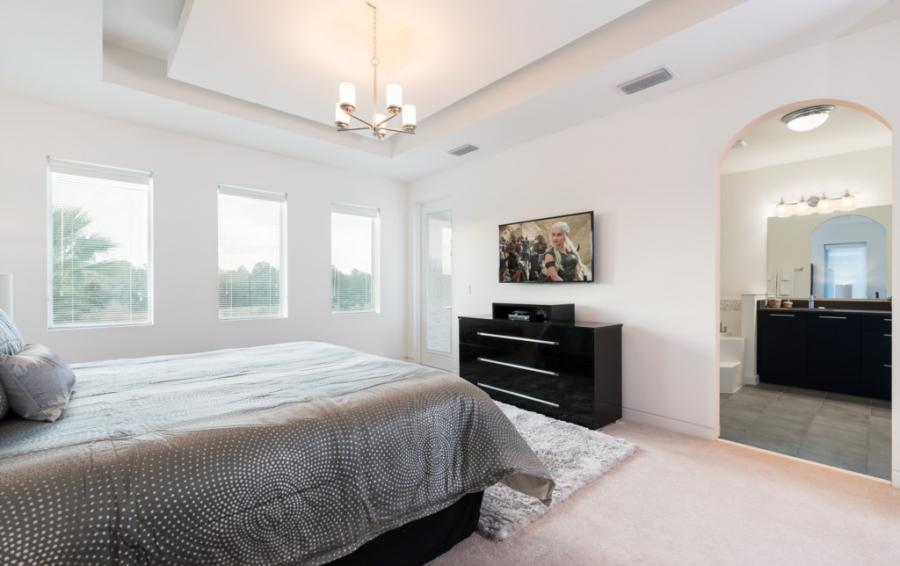 Bedroom - 1 -Master Suite Smart TV - On The Wind - 5 Bedroom Contemporary Luxury Orlando Area Vacation Home - Homes4uu