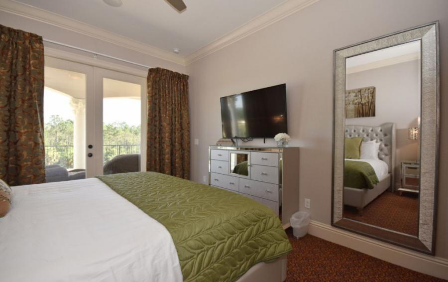 Bedroom - 4 - King Sized Bed with Balcony doors and seating - Swift Sailing - 6 Bedroom Custom Luxury Vacation Home - Homes4uu