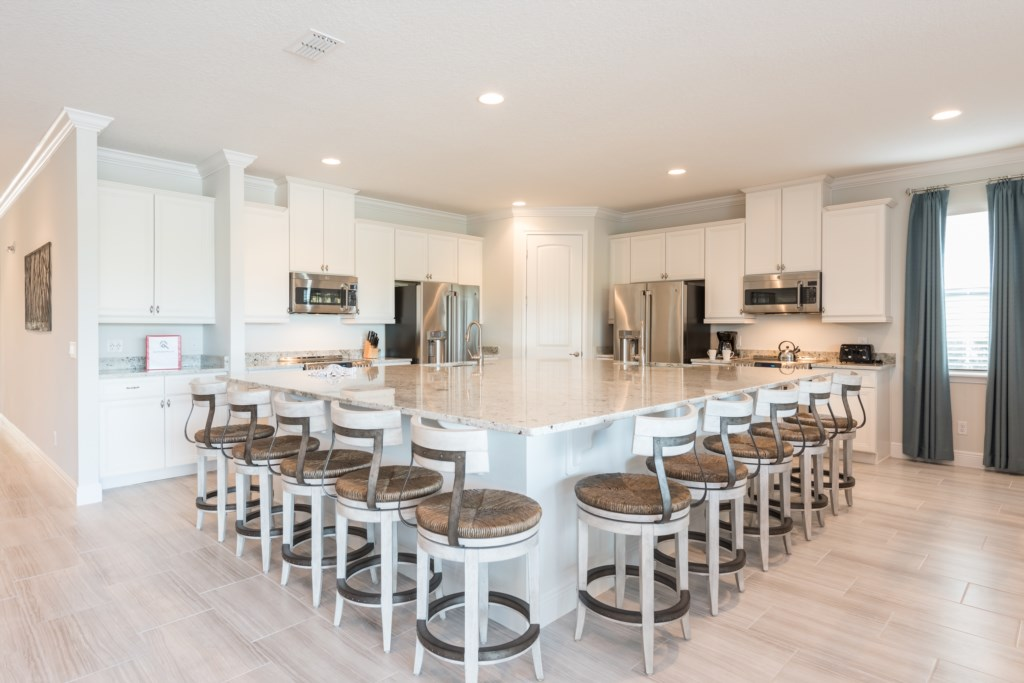Kitchen Breakfast Bar with Seating for Ten - 13 Bedroom Luxury Resort Orlando Vacation Home - Homes4uu