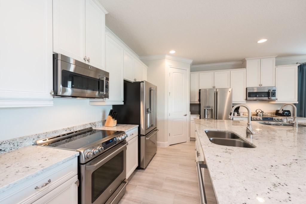 Kitchen with Proffetional Appliances - 13 Bedroom Luxury Resort Orlando Vacation Home - Homes4uu