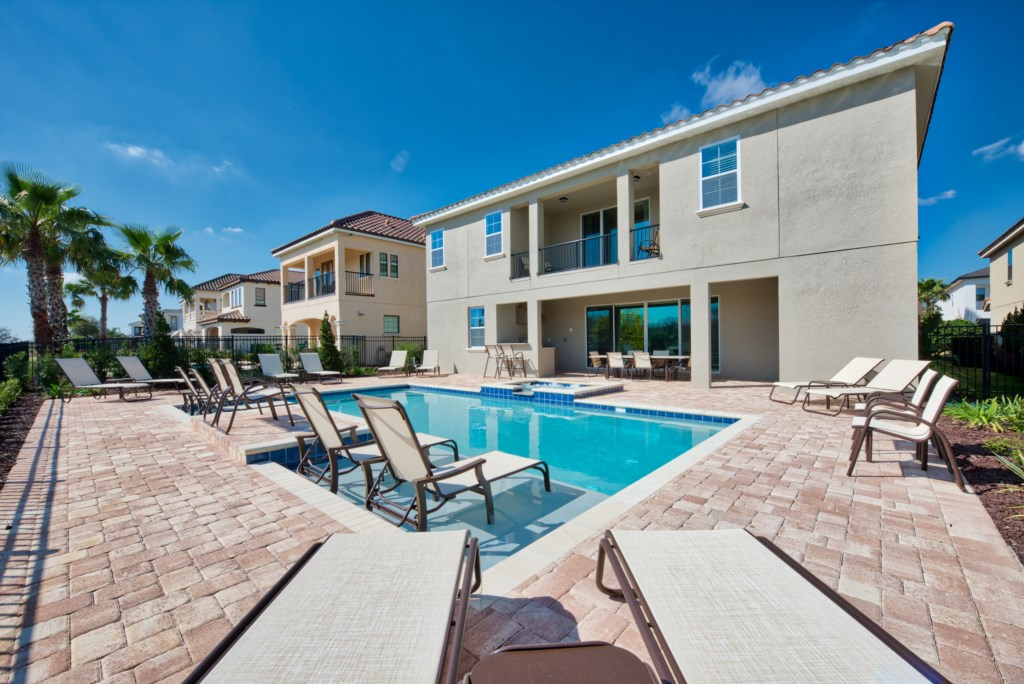 Pool With Lounge Chairs in the Pool - 13 Bedroom Luxury Resort Orlando Vacation Home - Homes4uu