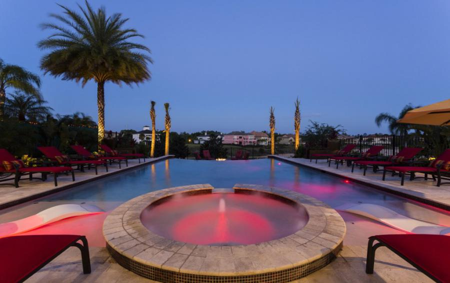Pool at Twilight with Lighting Features - Treasure Hunt - 8 Bedroom Hidden Mickey Vacation Home - Homes4uu