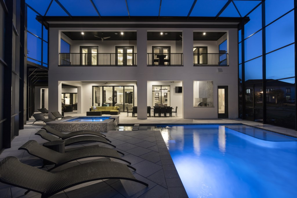 Rear View of Pool at Twilight - Hopesail - 10 Bedroom Reunion Resort Vacation Home - Homes4uu