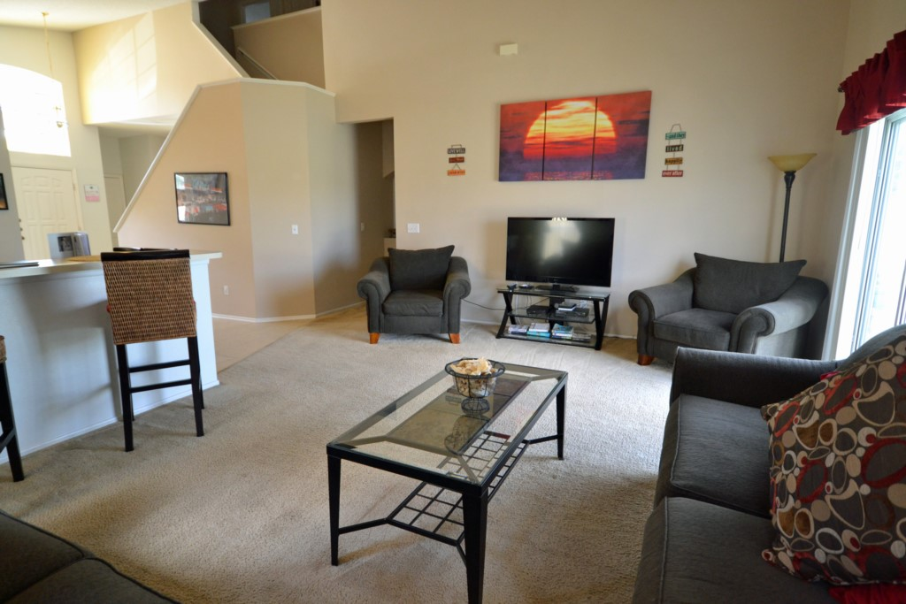 Great Room with Flat Screen TV - Lake View Villa - 5 Bedroom Disney Area Private Pool Vacation Home - Homes4uu