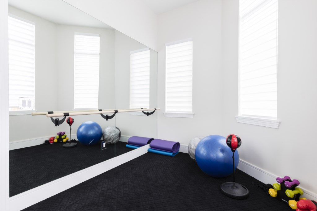 Fitness Room- Captain's Chair - 9 Bedroom - Luxury Orlando Vacation Home - Homes4uu