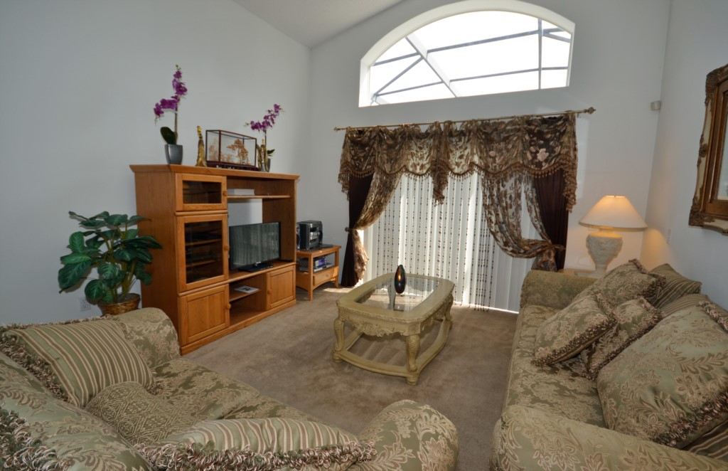 Living Room with Doors to the Pool and Lanai - Oriental Charm - 4 Bedroom - Disney Area Resort Vacation Home - Homes4uu