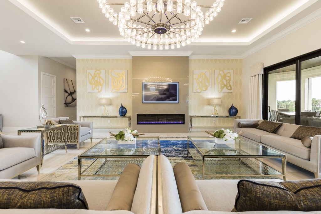 LivingRoom With 65 TV That Has A Tablet Control - Captain's Chair - 9 Bedroom - Luxury Orlando Vacation Home - Homes4uu