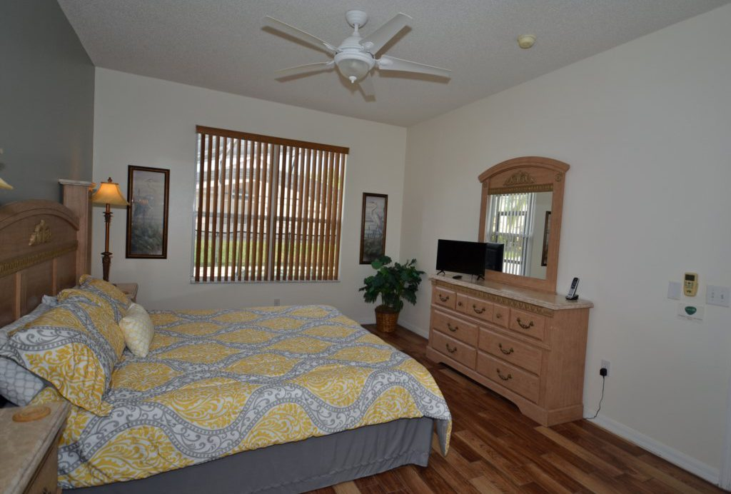 Bedroom - 1 - Master Suite King Bed With TV - St. Kitts - 6 Bedroom - Disney Area Family Vacation Home With Private Pool - Homes4uu
