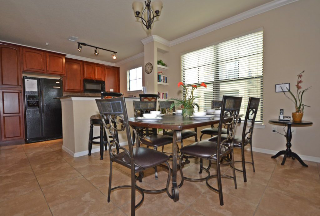 Dining Area And Kitchen - Summer Nights - 3 Bedroom Condo Disney Area Vacation Home-Home4uu
