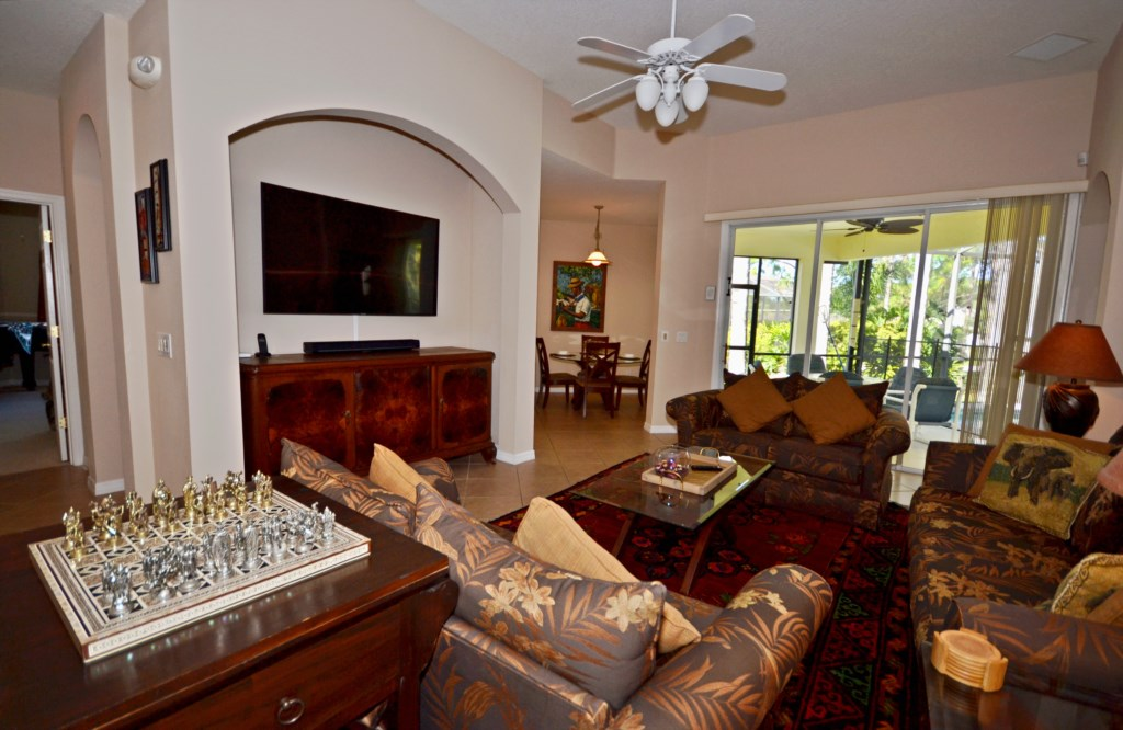 Family Room With Large TV and Chess Set - Villa Protea - 5 Bedroom - Disney Destination Custom Vacation Home - Homes4uu
