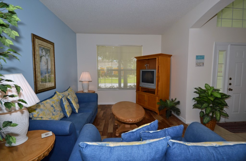 Family Room with TV- St. Kitts - 6 Bedroom - Disney Area Family Vacation Home With Private Pool - Homes4uu