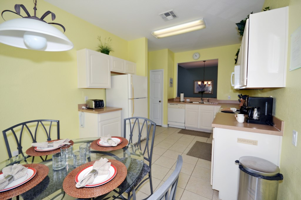 Kitchen And Breakfast Nook - Chateau Soleil - 5 Bedroom - Disney Area Vacation Home with Private Pool And Mickey Themed Bedrooms - Homes4uu