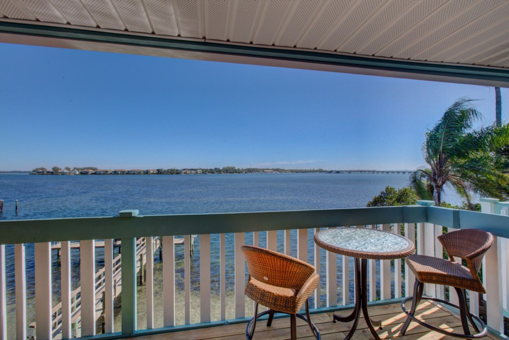 Balcony With Seating And Water View - Moon Snail - 2 Bedroom Anna Maria Island Vacation Condo - Homes4uu