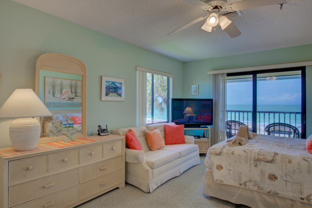 Bedroom - 1 - Master Suite Furnished With Large screen TV - Kitten Paw - 2 Bedroom Condo - Anna Maria Island Beach Vacation Condo - Homes4uu