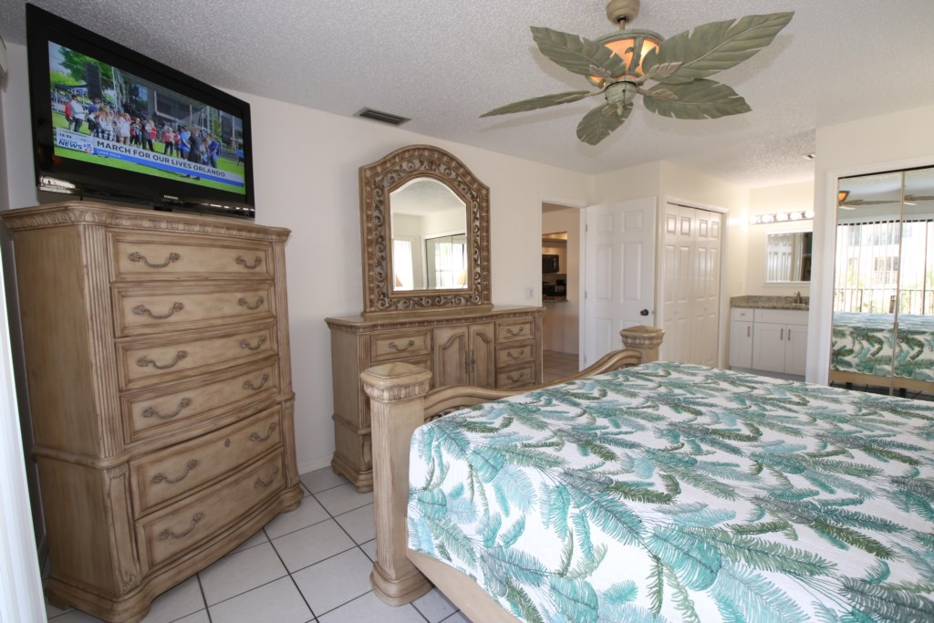 Bedroom - 1 - Master Suite King Size Bed With Large TV - Perrywinkle - 2 Bedroom Condo - Anna Maria Island Beach vacation Home - Homes4uu