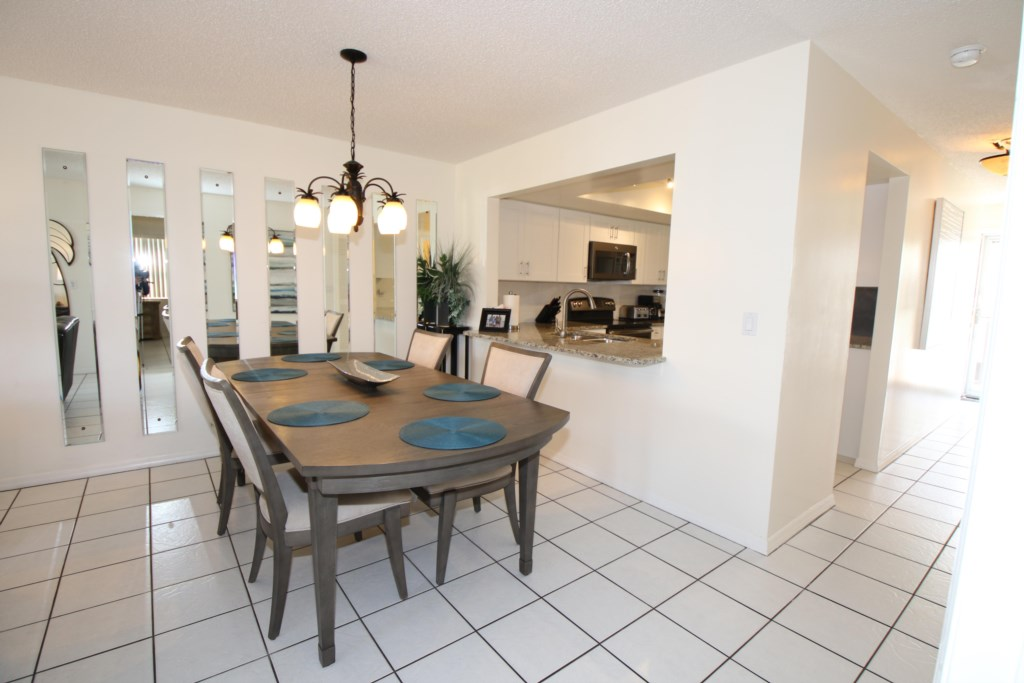 Dining Room and Kitchen - Perrywinkle - 2 Bedroom Condo - Anna Maria Island Beach vacation Home - Homes4uu