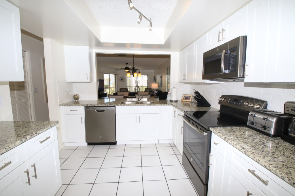 Kitchen With Stainless Steel Appliances - Perrywinkle - 2 Bedroom Condo - Anna Maria Island Beach vacation Home - Homes4uu