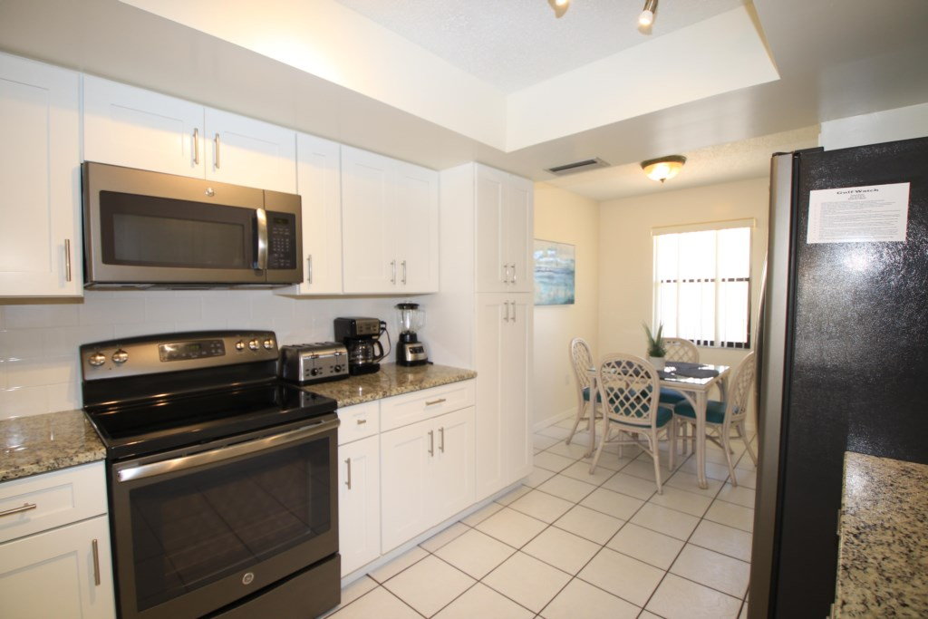 Kitchen with View into Breakfast Nook - Perrywinkle - 2 Bedroom Condo - Anna Maria Island Beach vacation Home - Homes4uu