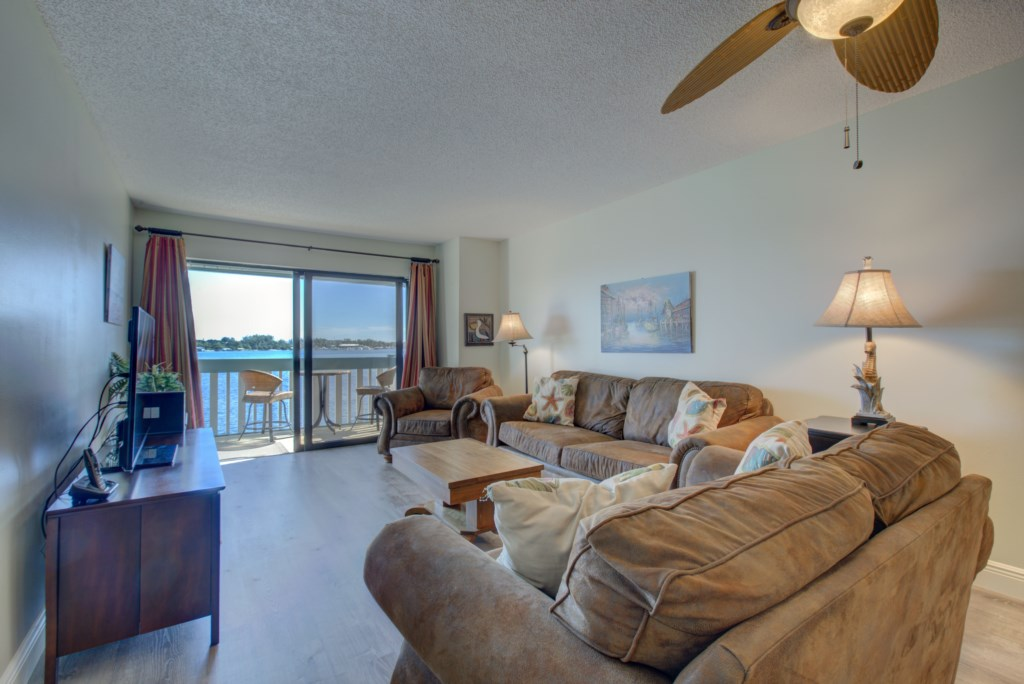 Living Room Couches Chairs and Private Balcony - Moon Snail - Anna Maria Island 2 Bedroom Vacation Condo - Homes4uu