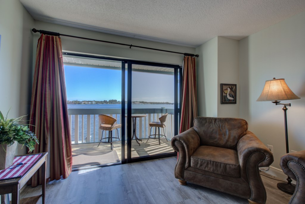 Living Room With Balcony and View of Water - Moon Snail - Anna Maria Island 2 Bedroom Vacation Condo - Homes4uu