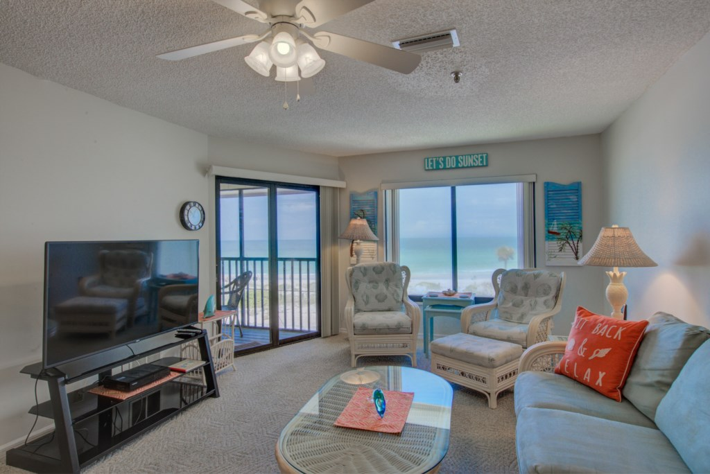 Living Room With Large-screenTV and View to Beach - Kitten Paw - 2 Bedroom Condo - Anna Maria Island Beach Vacation Condo - Homes4uu