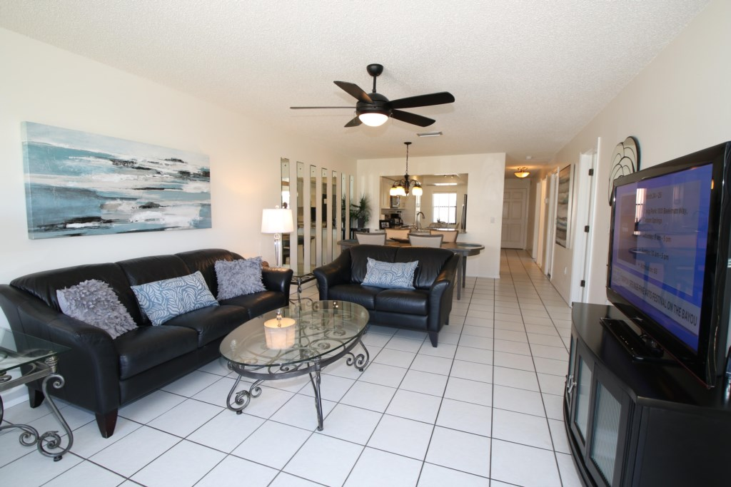 Living Room and Dining Table - Perrywinkle - 2 Bedroom Condo - Anna Maria Island Beach vacation Home - Homes4uu